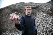 April 2008 - Dalmarnock youth - Tony stands amongst the rubble of the demolished high rise flats in Dalmarnock.  He offers me a piece of 'Dalmarnock Rock' as a sovenier the land in the area begins to be sold off and cleared to make way for the games