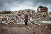 Margaret stands outside the remains of where her home once stood - Oct 2011